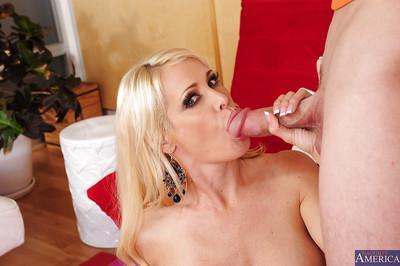 Lewd MILF Mikki Lynn gets her shaved cunt drilled tough and tastes a cumshot
