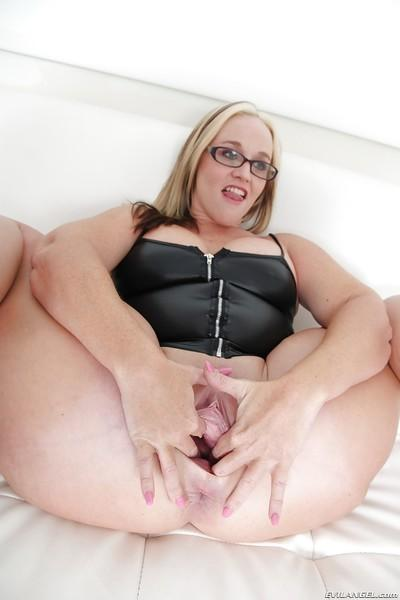 Fat milf with huge natural titties Dee Siren posing in a tight dress