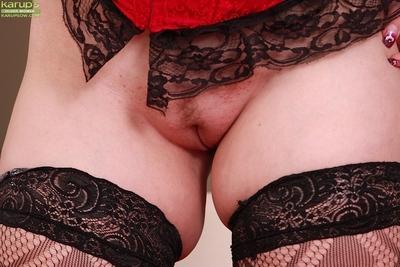 Mature redhead model Svitokova baring big butt in thong panties