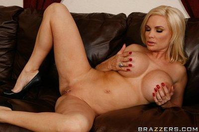 Busty milf in miniskirt Diamond Foxxx is touching her huge boobs