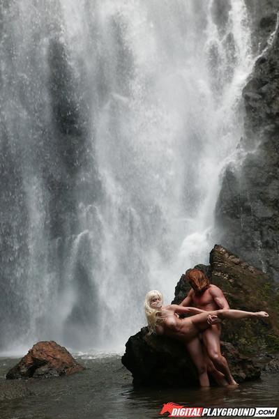 Stunning milf Jesse Jane fucks outdoor in the waterfall on cam