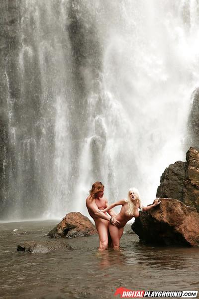 Stunning milf Jesse Jane fucks outdoor in the waterfall on cam