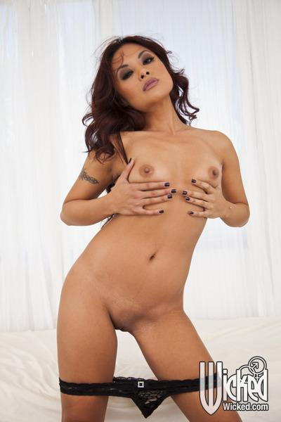 Tempting asian babe Kaylani Lei stripping off her dress and panties