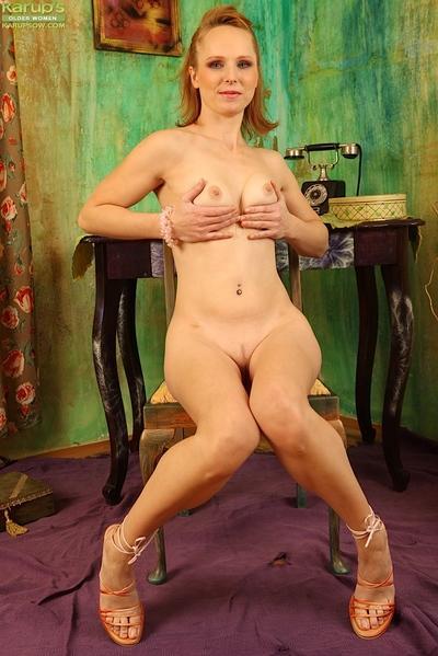 Sexy mom Paula strips off pink nylons to masturbate horny pussy