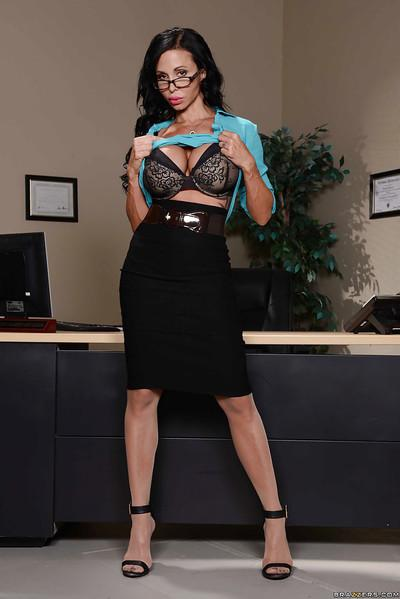 Buxom secretary Jewels Jade removes top and bra to flaunt massive melons