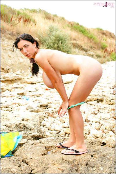 Buxom beach babe Anya Zenkova exposing massive melons outdoors