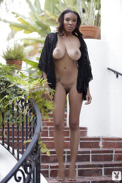 Desirable ebony temptress showing off her jaw-dropping hot body outdoor