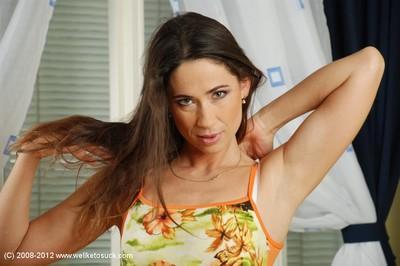 Gorgeous-looking brunette Pepper demonstrates her shaved vagina