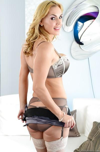 Hot MILF in stockings Tanya Tate stripping and slipping on a strapon