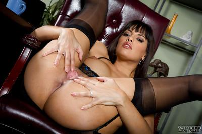 Latina beauty Mercedes Carrera posing solo in stockings and garters