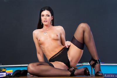Awesome brunette India undressing her black stockings on the table