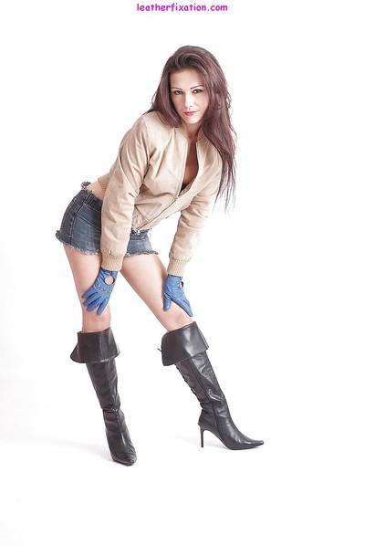 Hot MILF Tina models in leather boots, driving gloves and denim skirt