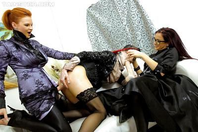 Fully clothed lesbians having fun with a strapon and gets bukkaked