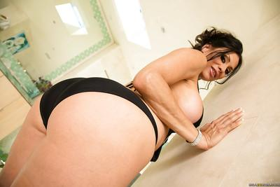 Saucy latina MILF in bikini stripping and exposing her big booty in close up