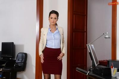 Brunette Euro babe Angie Moon stripping off nylons and skirt in office