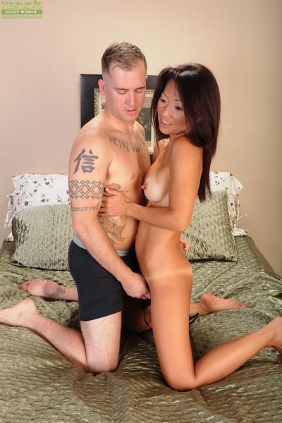 Lustful asian cougar with trimmed gash gets fucked and jizzed over her back