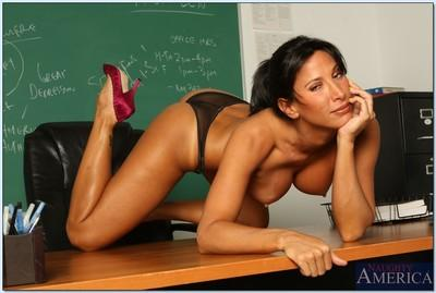 Appealing teacher Lezley Zen denudes ripe juggs and good looking pussy