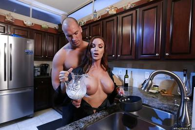 Chesty older MILF Diamond Foxxx giving big cock blowjob in kitchen