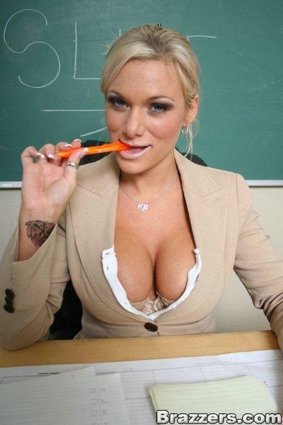 Busty MILF teacher Devon Michaels strpping in the classroom