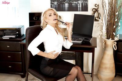 Immensely hot blonde lady uncovering her voluptuous curves at her work place