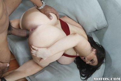 Daphne Rosen gives a titjob and gets her holes drilled by a big black cock