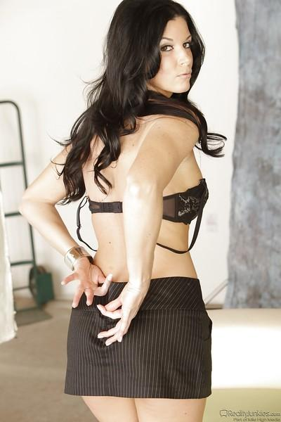 Dark haired milf India Summer is undressing and showing her asshole