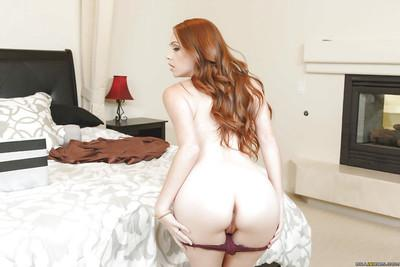 Hot redhead MILF Kassondra Raine undressing for blindfold sex action