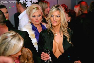 Glamorous european fashionistas getting naughty at the club party