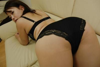 Asian MILF Mami Isoyama undressing and spreading her lower lips in close up