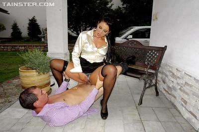 Fully clothed Valentina Ross gives a blowjob and gets shagged outdoor