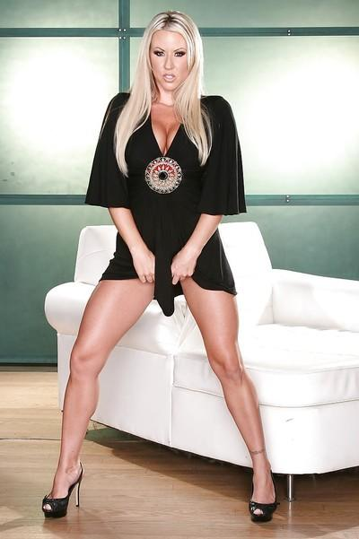 Curvy blonde MILF Carolyn Reese undressing and spreading her legs