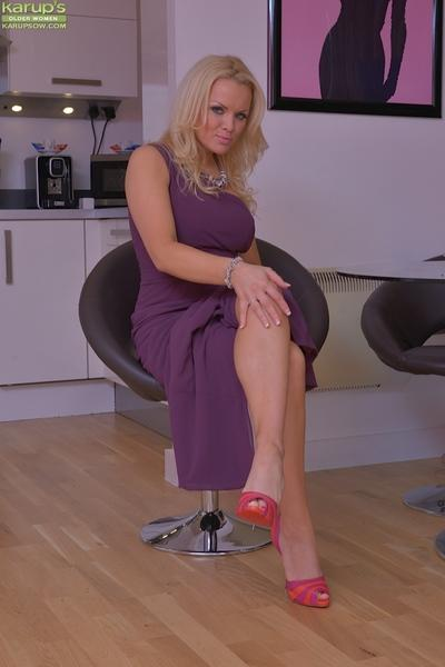 Blonde Euro wife Frankie Babe poses fully clothed in long dress