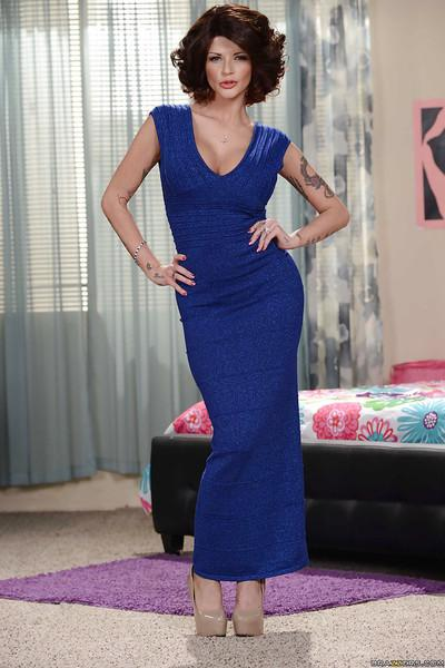 Tall and tattooed mom Joslyn James posing fully clothed in long dress