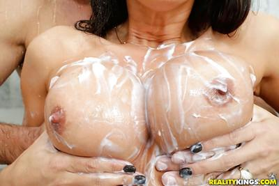 Brunette MILF Lezley Zen having big wet tits soaoed up in shower