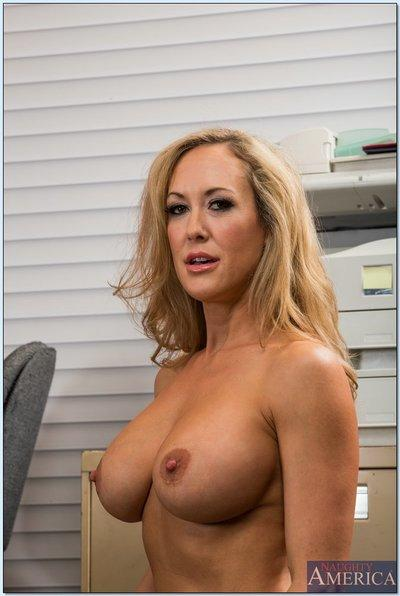 Tempting MILF Brandi Love stripping off her suit and lingerie