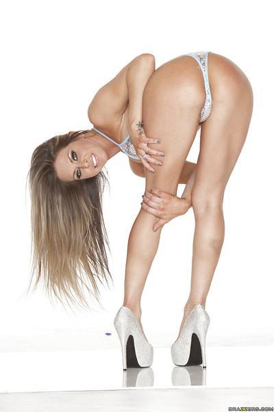 Bikini model Rachel RoXXX posing in a hot swimsuit and high heels