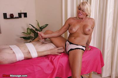 Blonde massage worker goes topless while coaxing cum from cock
