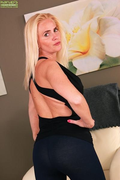 Over 40 Euro MILF Sevikova pulling down yoga pants to reveal ass cheeks