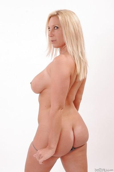 Milf blonde Devon Lee lifts her dress and shows an amazing butt