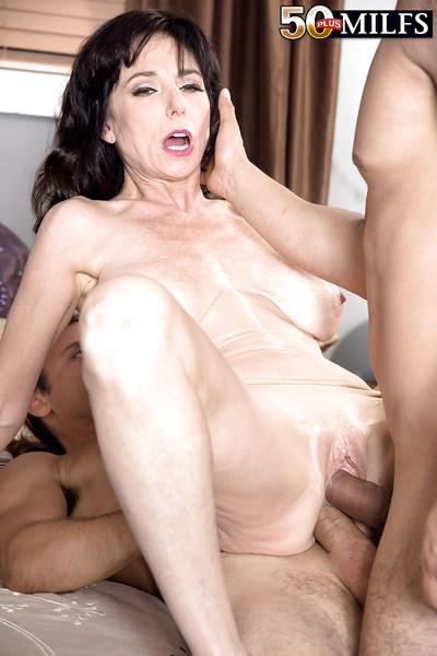 Busty brunette MILF Karen Kougar taking double penetration in MMF threesome