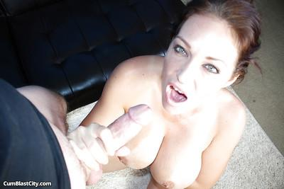 Busty brunette is masturbating this hard dick and getting facial