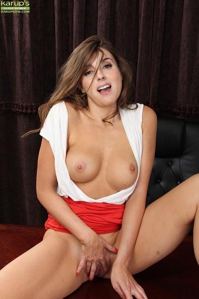Brunette milf with curly hair Veronica Shaw showing her titties