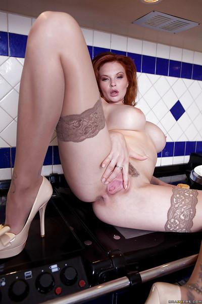 Gorgeous redhead MILF in stockings undressing and teasing her gash