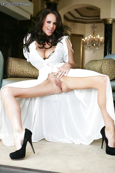 Kelly Madison demonstrates her long legs and her perfect ass