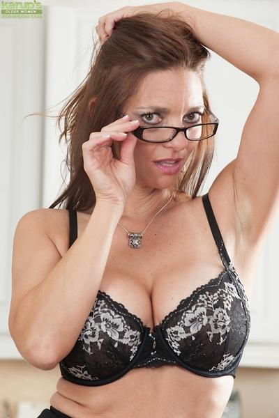 Brunette milf babe Mindi Mink shows off in lingerie and glasses