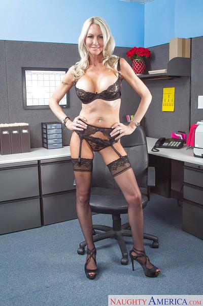 Blonde milf Emma Starr shows her big boobies and black stockings