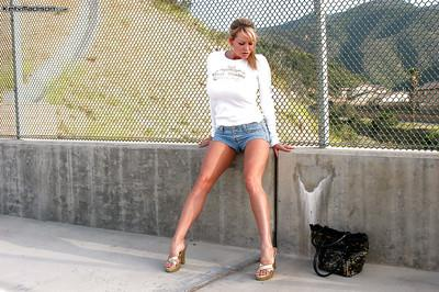 Outdoor posing scene features an amateur blonde milf Kelly Madison
