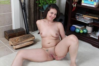 Chubby dark haired solo girl Penny Prite exposing small MILF tits