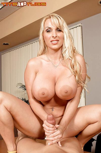 Blonde mom Holly Halston using large boobs to tit fuck cock in office