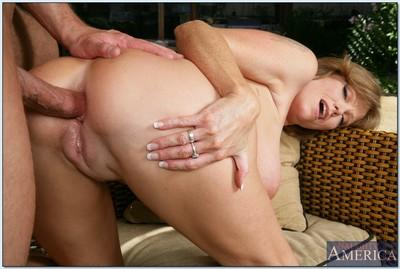 Redheaded MILF in glasses Darla Crane takes hard anal fucking outdoor